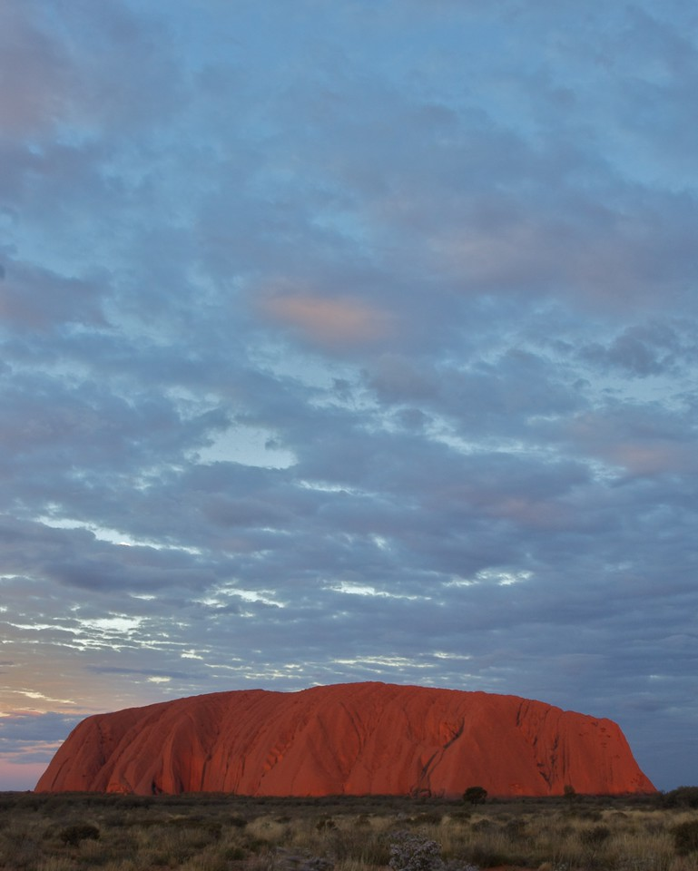 The changing face of Ayers' Rock 15 • It is frequently said that Ayers'Rock changes colour as the sun sets. This series of photos demonstrates how true that assertion is.<br /> <br /> Just before the sun disappears from the sky, the Rock appears to glow a deep red colour.