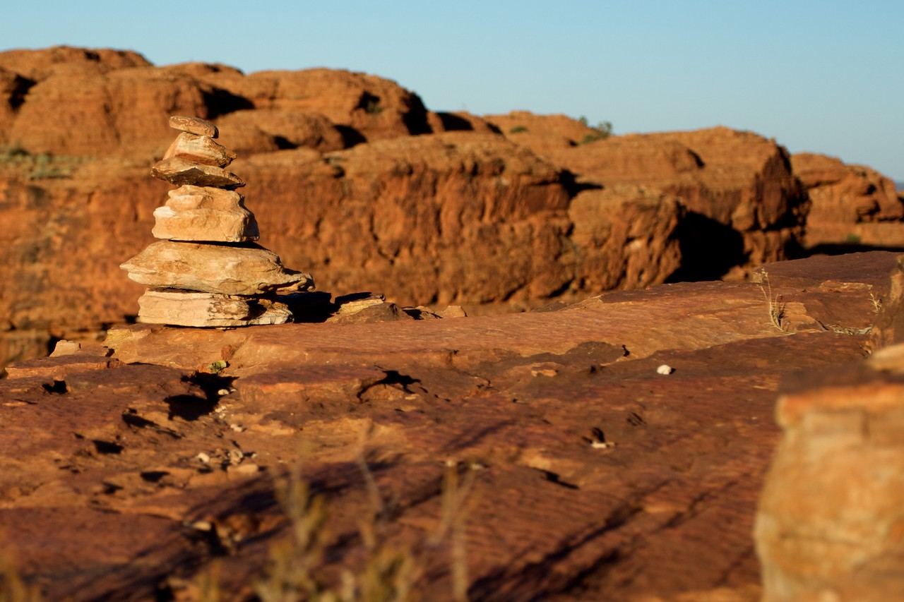 Stones • A pile of stones at the top of the rim of King's Canyon in the Northern Territory in the early-morning sunlight.
