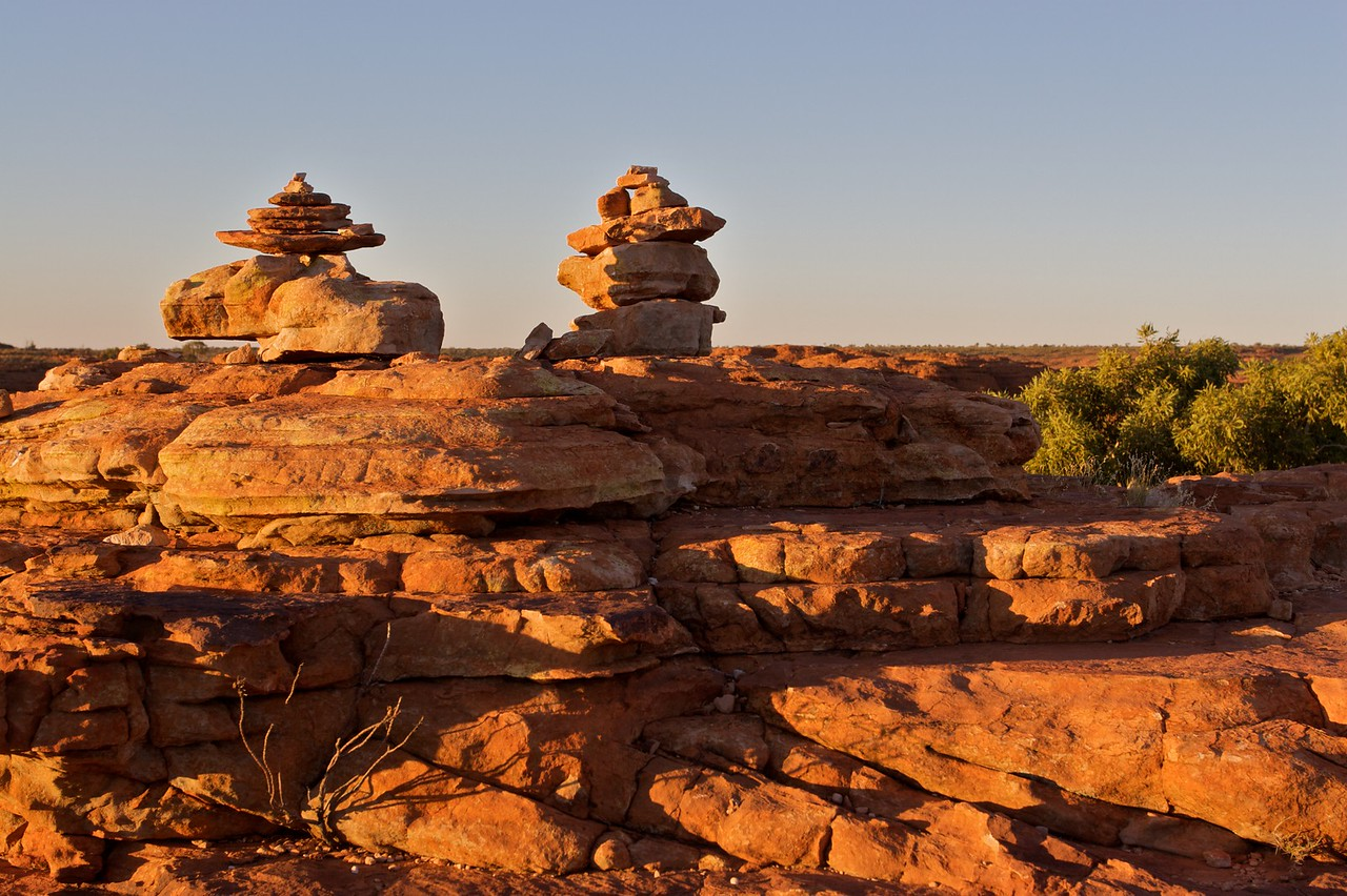 Stones • Piles of stones at the top of the rim of King's Canyon in the Northern Territory in the early-morning sunlight.