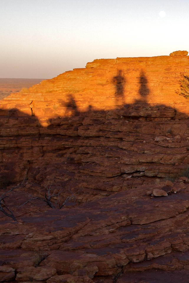 Shadows on the Canyon • The shadows of some French tourists projected onto an adjacent peak of King's Canyon in the Northern Territory.