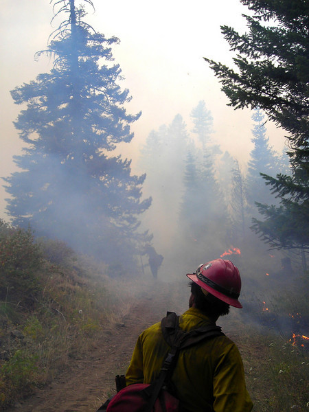 Smoke gets thick and impairs the holding crew's ability to see spot fires starting up on the wrong side of the fireline.
