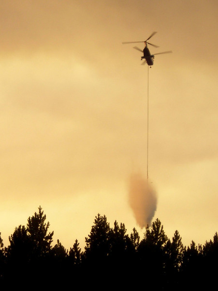 The Chinook can carry a lot of water, but not enough to stop this fire on its own.