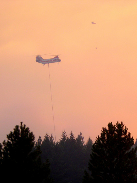 Several helitack crews went to work, as well as all available firefighters on the fireline, stopping this advancement before it took out our incident command center.