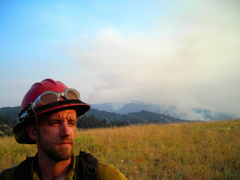 As evening progressed, our flank of the fire made a run up a hillside one valley over.  Michael Mulcahy stands in front of the smoke.