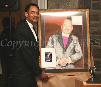 Elijah Beamon unveils the portrait of Bishop Battle he painted at the AME Zion Church 180 Anniversary.  Chuck Stewart, Jr./HUDSON VALLEY PRESS