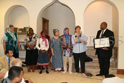 Imam Salahuddin Muhammad accepts Ambassador of Peace Award during the grand opening of Masjid Al-Ikhlas.