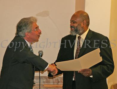Mayor Nick Valentine give a porclamation to Imam Salahuddin Muhammad during the grand opening of Masjid Al-Ikhlas.
