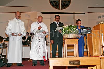 Bishop Brown, Bishop Moses, Pastor Herring and Dr. Gilliams read the dedication for Mt. Carmel Church.