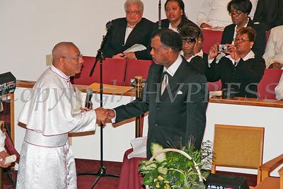 Bishop MacDonald Moses congratulates Pastor Thermond Herring during the dedication of Mt. Carmel Church.