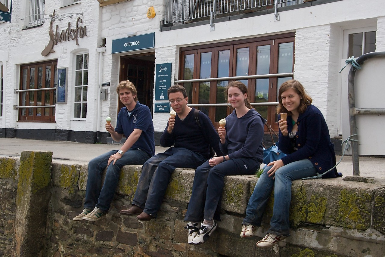 Eating ice cream • Charlie, Prof. Leigh, Isobel, and Leah. We got very wet during the walk from Gorran Haven to Mevagissey; while we were having lunch, however, the sky cleared and the sun came out. After lunch we therefore took the opportunity to do a bit of drying-out.