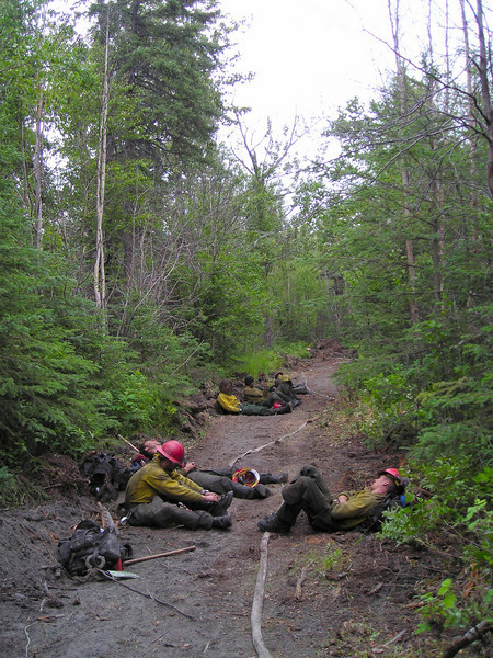 The crew takes thirty minutes of rest after knocking down the fire, and then moves into several more hours of mopup.