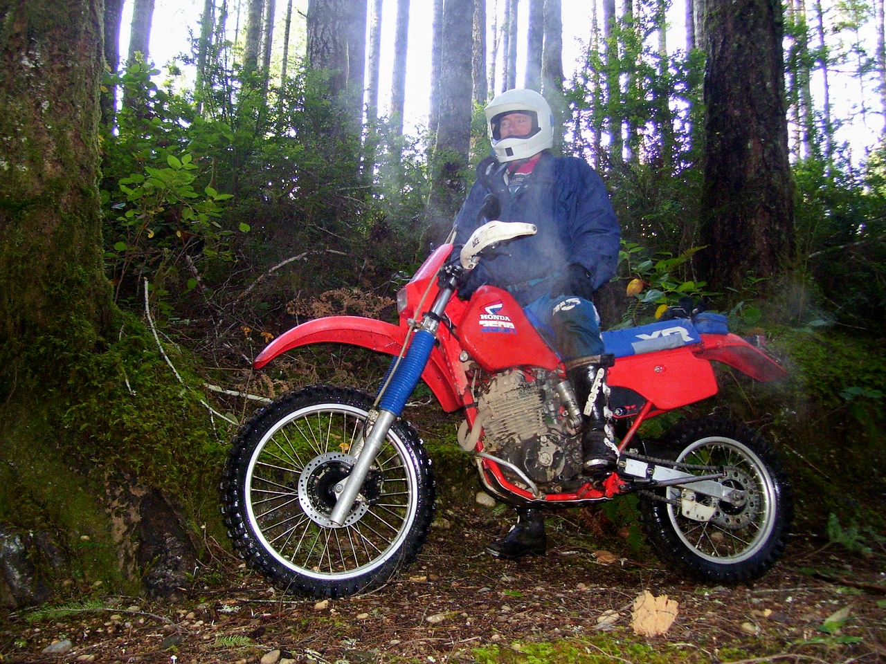 Wild Bill and his XR 350. These Older XRs work really good in the woods, with their shorter wheel base and quick steering and lower seat height.