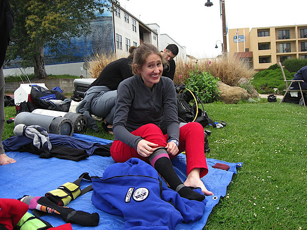 Katy getting all her warm clothing on before our first Dry Suit dive