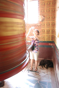 Giant prayer wheel with Rachel and dog sleeping in the corner.  It was cool in there, so the dogs knew just where to lie.