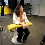 With a hand from Michelle, Kara models some funky furniture at the National Academy for Finances and Economy in The Hague