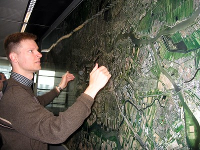 William studies an aerial photograph of the Port of Rotterdam