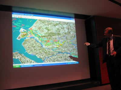 A representative of the Port of Rotterdam explains the system that tracks all ship movement throughout the port