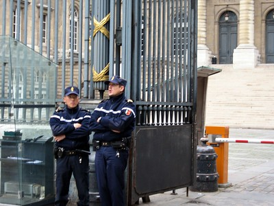 Police officers in front of the Palais de Justice in Paris