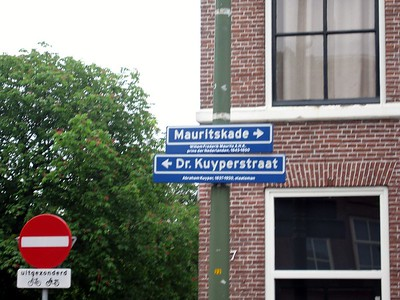 Many street signs in Europe, like these in The Hague, give a brief explanation of the person in whose honor the street was named