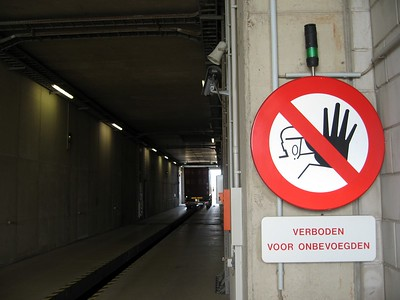 This sign, which warns that unauthorized persons are prohibited in the nuclear scanning tunnel operated by the Dutch Customs Administration at the Port of Rotterdam, appears to take advantage of the common Dutch fear of space aliens