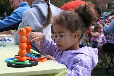 Inessa Joseph, 3-years-old, plays the YMCA Three Ring Toss