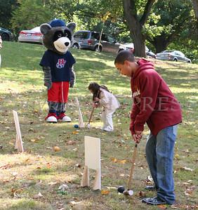 Children enjoy play croquet