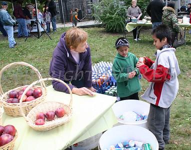Barbara Valentino serves apples and soda to kids