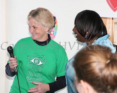 House Captain Celeste Bloomer presents Shalanda Williams with keys to her new house