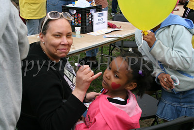 "Ramona Burton paints Jasmin Fraiser face during the Habitat for Humanity of Greater Newburgh ""Walk for Housing."""