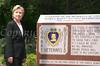 Hillary Clinton next to Purple Heart Monument