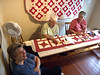 Work work work...<br /> <br /> The quilts are double stitched and for sale.<br /> They make and sale a few quilts each year.<br /> Keeps them out of trouble. :)<br /> <br /> From left to right; Betty, Irene, Lorraine