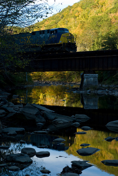 A recrewed Q436 heads east on track 2 on Bridge BR 124.47 over the Westfield River in CSX's Berkshire Sub. Chester, MA October 16, 2007