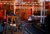 Amtrak 135 passes a Metro North surfacing gang which is clearing up for the night at Milford on the New Haven Line. November 10, 2007.
