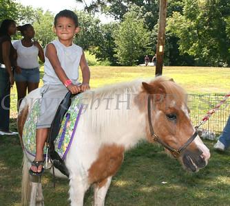 Aavon Davis takes a ride on Daisy the pony