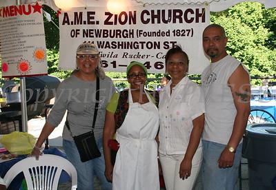 Karen Daniels, Linda Burger, Luisa Reyes, and Pablo Quinones at AME Zion church booth