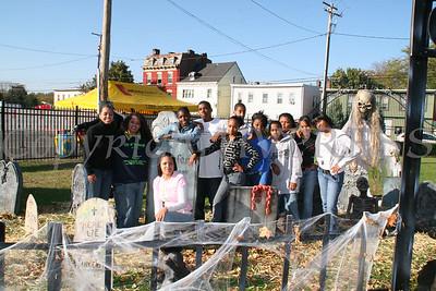 Samantha Rogers, Maritza Wilson and Liberty Partnership volunteers in the graveyard