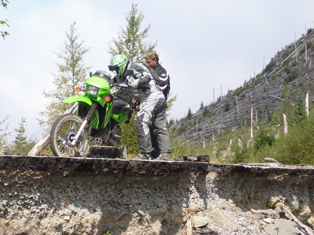 """Keith and Mark deciding whos going to ride """"Kermit"""" around the washout."""