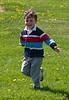 Joey running in the grass.