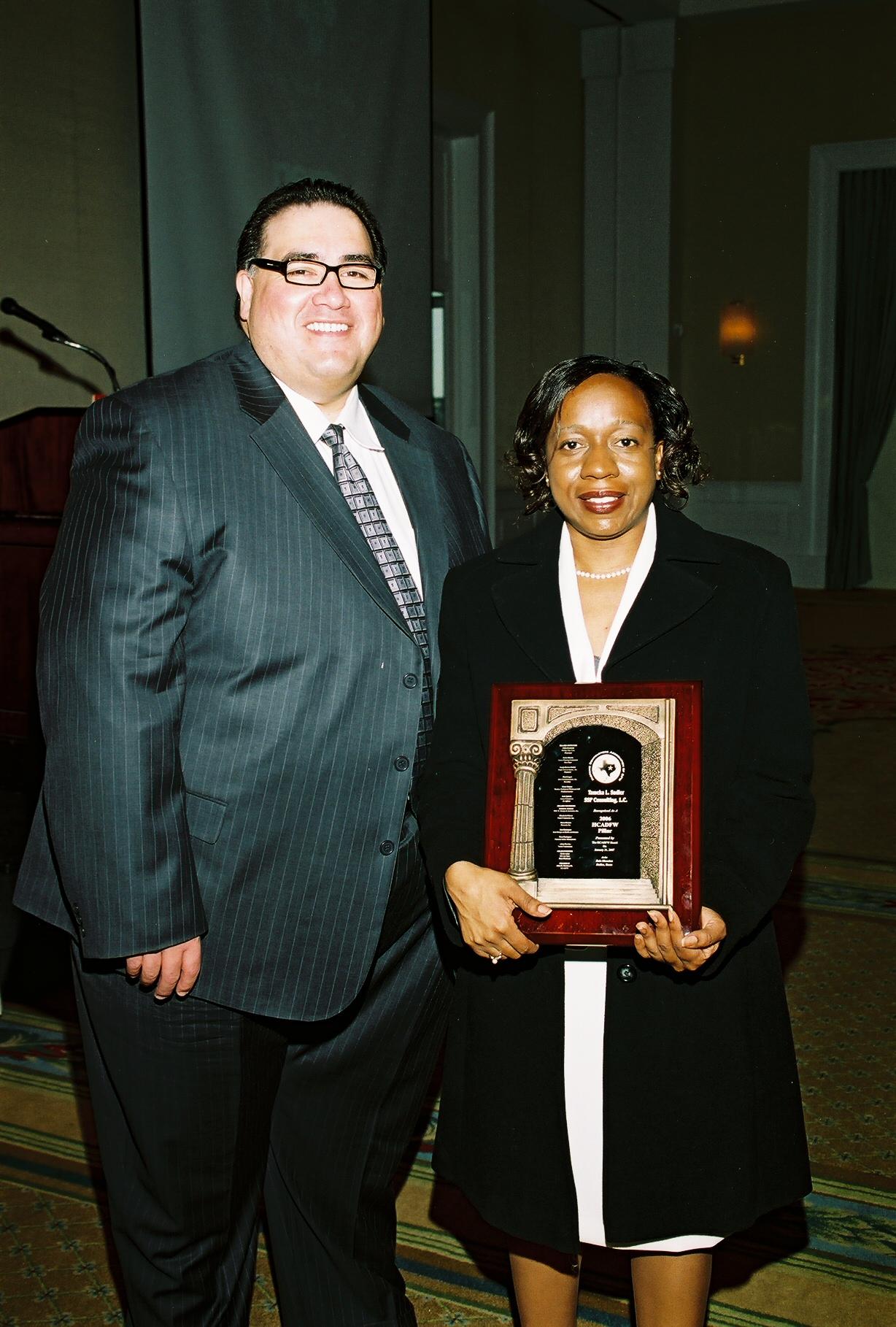John H. Martínez-D., HCADFW President and Tameka Sadler, SSP Consulting and HCADFW Pillar Awardee