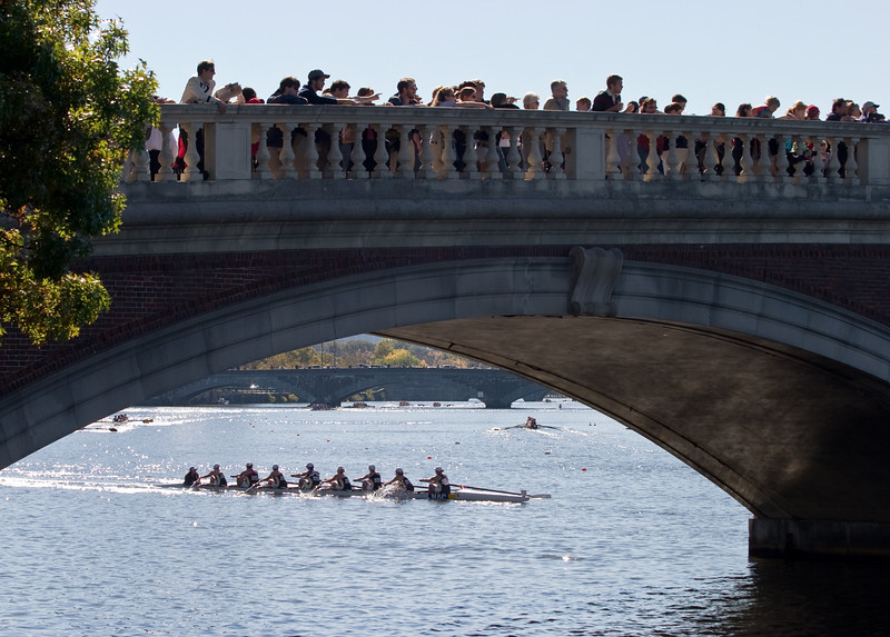 Spectators on the Weeks bridge, with boats coming through.