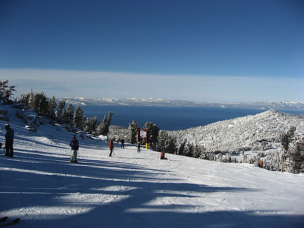Heavenly looking down on Lake Tahoe, from the top of Comet. That's me in the blue jacket on the left side