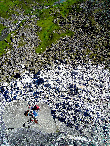 Richard Harrop tops out on the offwidth section and greets Kelsey and Shasta at the belay.