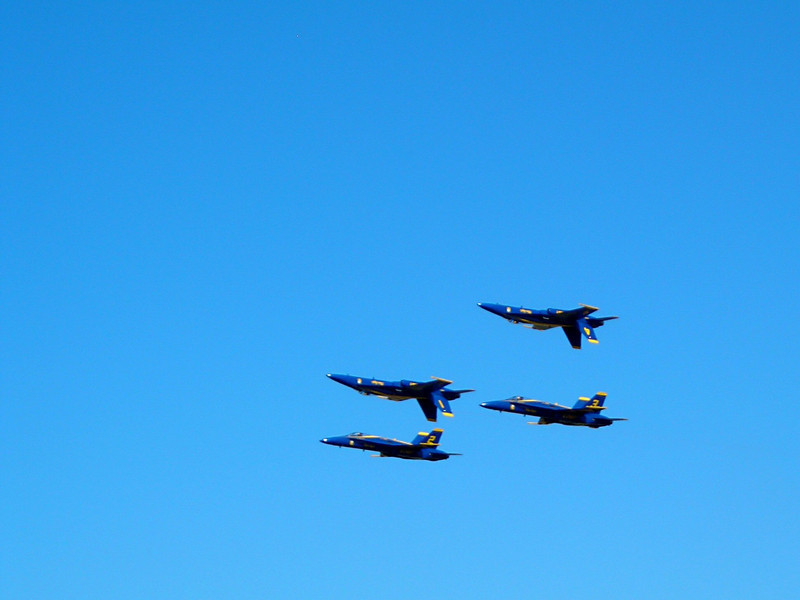 Four of the Blue Angels flying by.