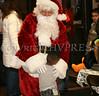 Santa is greeted with a big hug