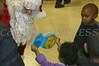 Excited children greet Santa