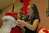 Santa's helper adjusts his hat