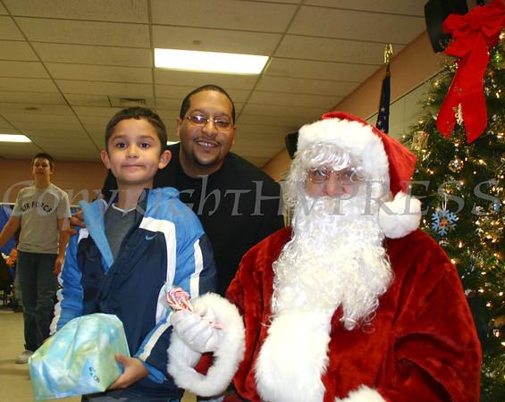 Santa poses with children