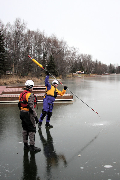 Joe Sylvia tests the ice strength with Jason Starret before moving out further.