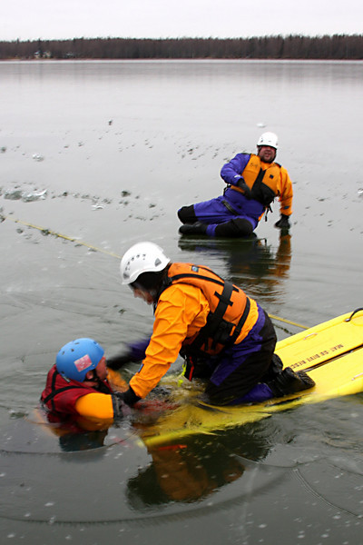 Jennifer Gourley goes in to rescue Cliff Silvers using our ice rescue sled.