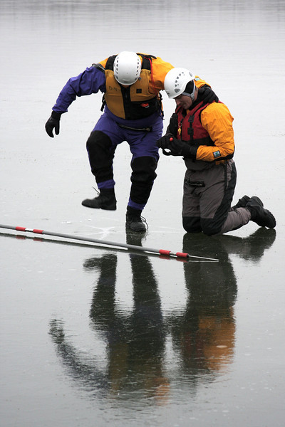 Jason Starret lends a shoulder for Joe Sylvia as he tries to break through the ice.